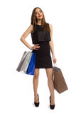 Woman in black dress holding bags Royalty Free Stock Photos