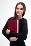 Woman in black dress holding gift box Stock Image
