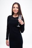 Woman in black dress holding glass with champagne Stock Image