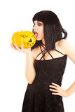 Woman in black dress holding a Jack-o'Lantern Stock Photos