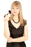 Woman in black dress holding a powder brush Royalty Free Stock Photo