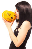 Woman in black dress holding a pumpkin Stock Photo
