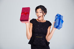 Woman in black dress holding two gift boxes Stock Photography