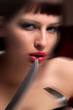 Woman in a black dress with a knife Royalty Free Stock Images