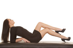 Woman black dress lay back head back Royalty Free Stock Photography