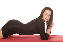 Woman black dress lay front look red sheet Stock Photography