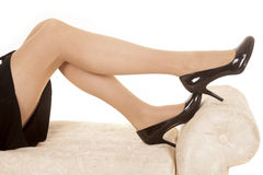 Woman black dress legs on bench heels Royalty Free Stock Photo