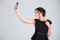 Woman in black dress making selfie photo Royalty Free Stock Photo
