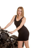 Woman black dress and motorcycle handlebars looking Royalty Free Stock Images