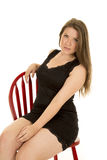 Woman Black Dress On Red Chair Serious Royalty Free Stock Photography