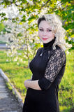 Woman in black dress over spring orchard Royalty Free Stock Photography
