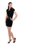Woman in black dress posing Stock Images
