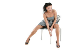 Woman in black dress posing in studio Stock Photo