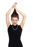 Woman in black dress pulling Stock Photography