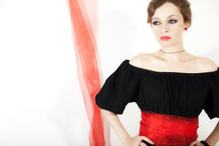 Woman in black dress with red sash Stock Photography
