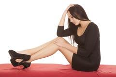 Woman Black Dress Sit Red Sheet Stock Photo