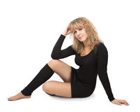 Woman black dress sits on the floor Royalty Free Stock Photography