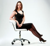 Woman in black dress sitting on the office Stock Photos