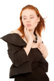 Woman in black dress standing Royalty Free Stock Images