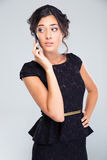 Woman in black dress talking on the phone Royalty Free Stock Photo