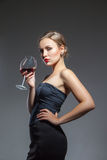 Woman in black dress with wine glass Royalty Free Stock Images