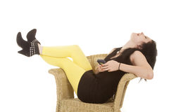 Woman black dress yellow legs phone laugh Stock Photography