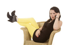 Woman black dress yellow legs phone mad Stock Images