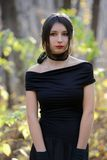 Woman in black dress. Young woman in black dress Royalty Free Stock Image