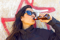 Woman in black drinking beer Royalty Free Stock Image