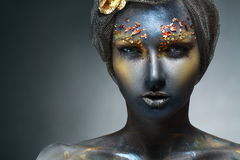 Woman with black face. Art photo of a beautiful woman with black face. Art face art fantasy make up Stock Images