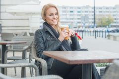Woman in Black Fashion Having Coffee at Cafe Royalty Free Stock Photo