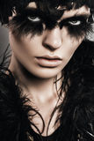 Woman with black feathers on eyes and head Royalty Free Stock Photo