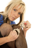 Woman black fishnets hold handcuffs look looking Stock Images