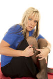 Woman black fishnets hold handcuffs look scared Stock Photography
