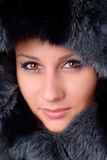 Woman and black fur. Face of a beautiful woman in black fur Stock Photography