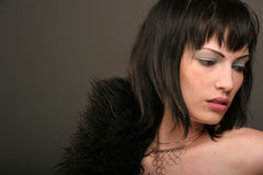Woman with black fur coat. Seductive young woman with black fur coat, studio background royalty free stock photo