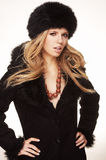 Woman in black fur hat and coat Royalty Free Stock Image