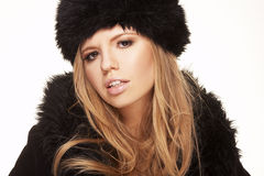 Woman in black fur hat and coat Stock Image