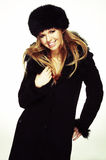 Woman in black fur hat and coat Stock Photography