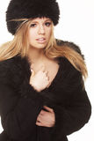 Woman in black fur hat and coat Royalty Free Stock Photos