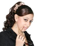 Woman in black glasses. The attractive girl thoughtfully looks forward Royalty Free Stock Photography