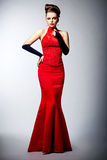 Woman in black gloves and wedding red dress posing Royalty Free Stock Image
