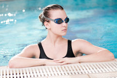 Woman in black goggles in swimming pool Stock Photography