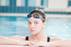 Woman in black goggles in swimming pool Stock Images