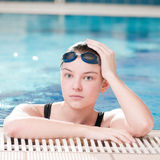 Woman in black goggles in swimming pool Royalty Free Stock Image