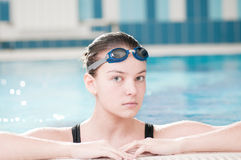 Woman in black goggles in swimming pool Royalty Free Stock Photography