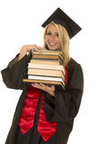 Woman in black graduation gown hold stack of books Stock Photos