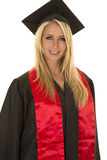 Woman in black graduation gown portrait Royalty Free Stock Photo