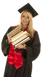 Woman in black graduation gown stack of books tipping Stock Photography