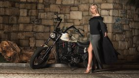 Woman In Black and Grey Long-sleeved Dress Standing Beside Cruiser Motorcycle Stock Image